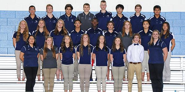 Sophomore Blake Frier, the only one in white, smiles for his group picture with his team.