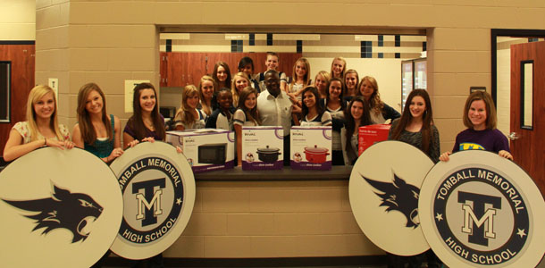 Wal-Mart manager Cleveland Landheart brought a donation of kitchen supplies to the TMHS ARC Committee.