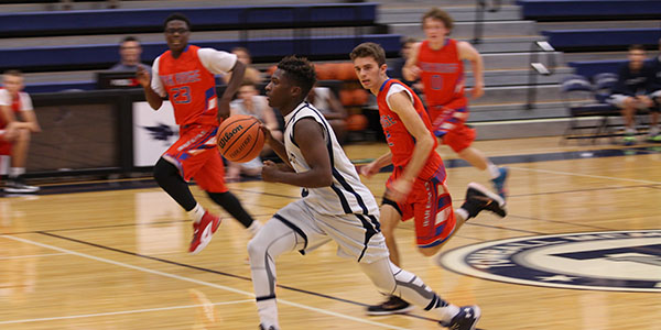 Boys Basketball Wins Season Opener