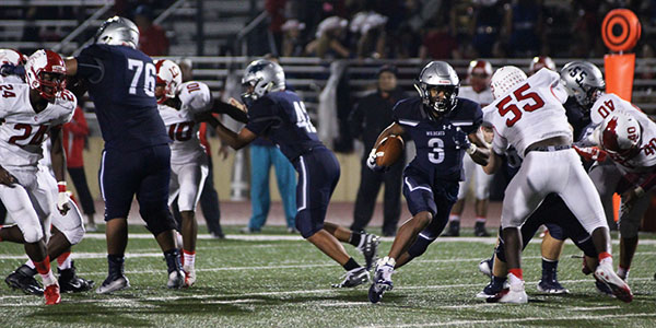 Wildcats secure playoff spot in rain-soaked victory over Cy Lakes