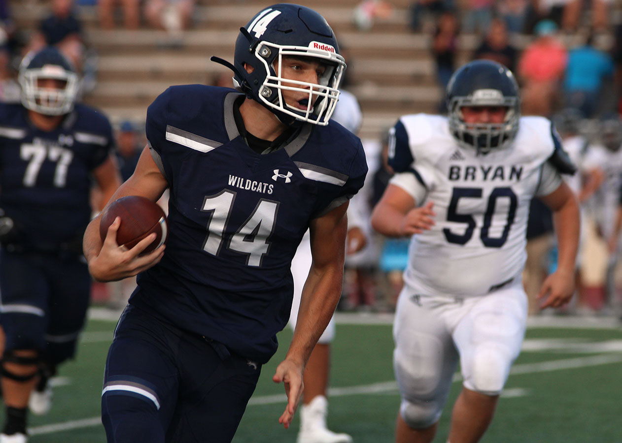 Junior Joseph Manjack runs the ball during the Bryan game
