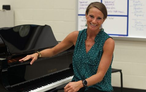 Assistant Choir Director Kimberly Dillow sits at a piano in the choir room. Dillow has begun teaching as a new assistant director this school year.