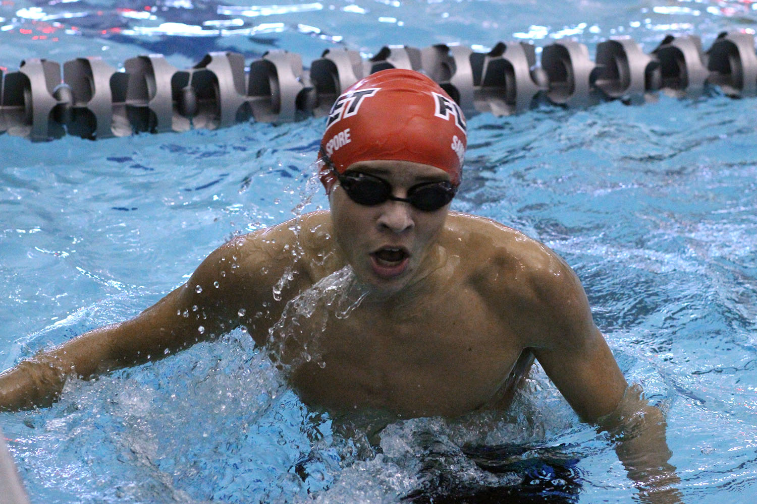 Sophomore Alex Sancho-Spore takes a breath in the water.