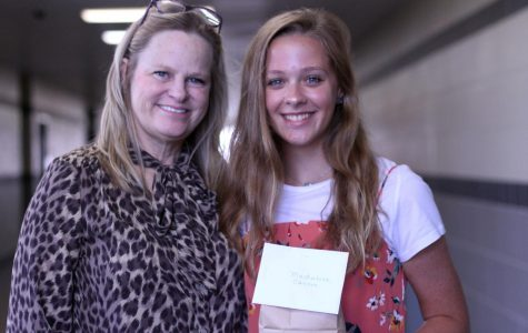 Along with several other teacher-senior pairs, English teacher Tancy Juliano brought a small gift to her adopted senior, Madaline Cannon, to commence the senior adoption program.