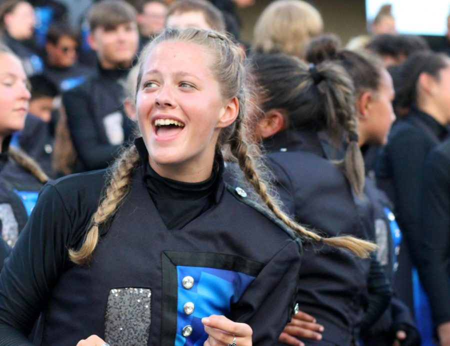Senior Madaline Cannon laughs in the stands.