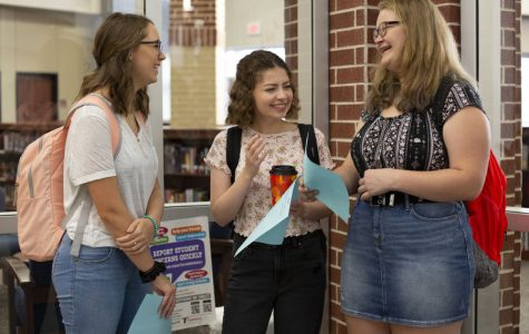 Students discuss their schedules on the first day of school.