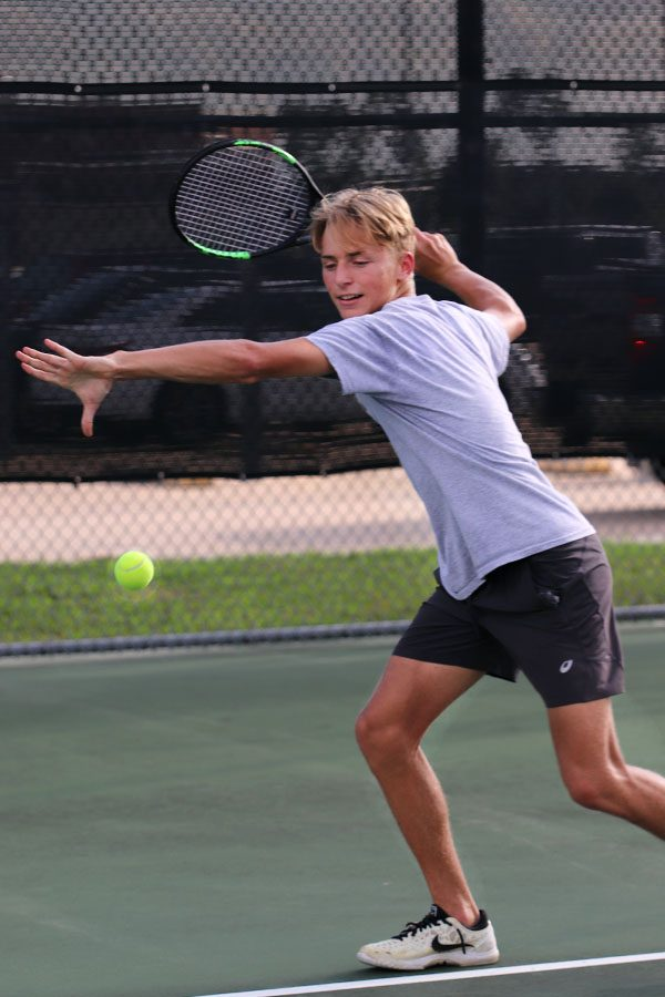 Junior and Varsity Tennis player Gavin McCorkle prepares for the fall season.