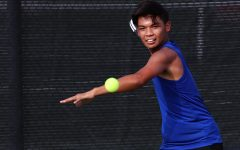 Senior and Varsity Tennis player Bryce Canillo practices serves for the season.