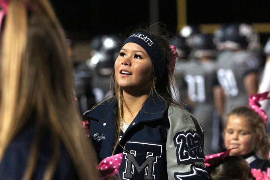 Sophomore cheerleader Kaylee Phrasavath smiles at the audience during the game.