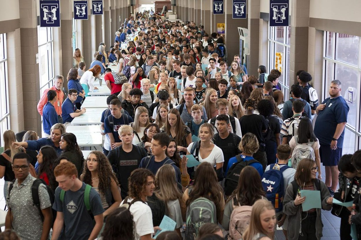 "Students clamor through the hallways toward class on the first day of school. ""It's like being stuck in traffic,"" sophomore Katelin Callahan said. ""You can feel everyone else's body heat, and someone's always breathing down your neck and bumping into your backpack."" The additional construction planned for 2020 was intended to accommodate the oversized student body."