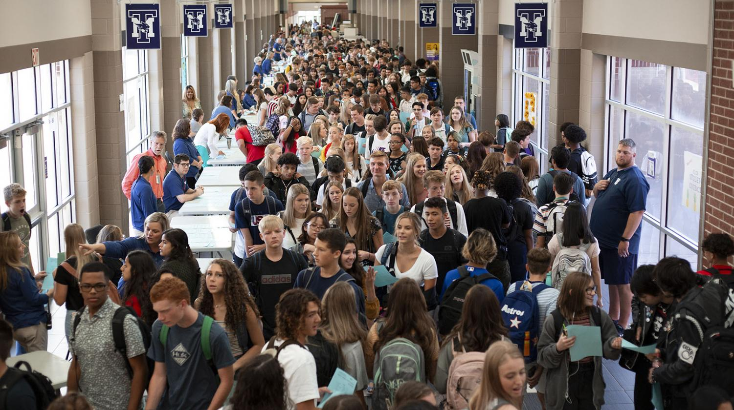 """Students clamor through the hallways toward class on the first day of school. """"It's like being stuck in traffic,"""" sophomore Katelin Callahan said. """"You can feel everyone else's body heat, and someone's always breathing down your neck and bumping into your backpack."""" The additional construction planned for 2020 was intended to accommodate the oversized student body."""