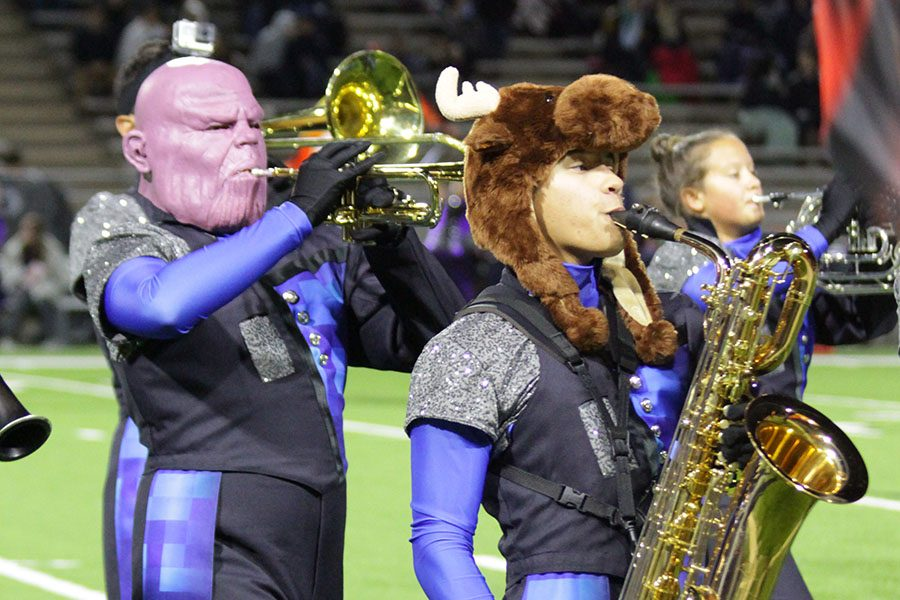 Members of the band march on Halloween.