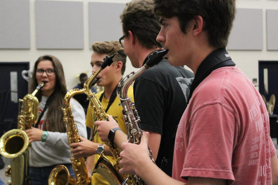 Members of the quartet rehearse in the band hall.