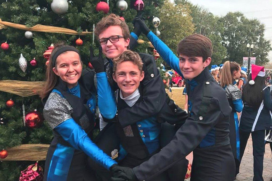 The four quartet members pose at the Tomball Holiday Parade. The four have played at various events over the past five years.