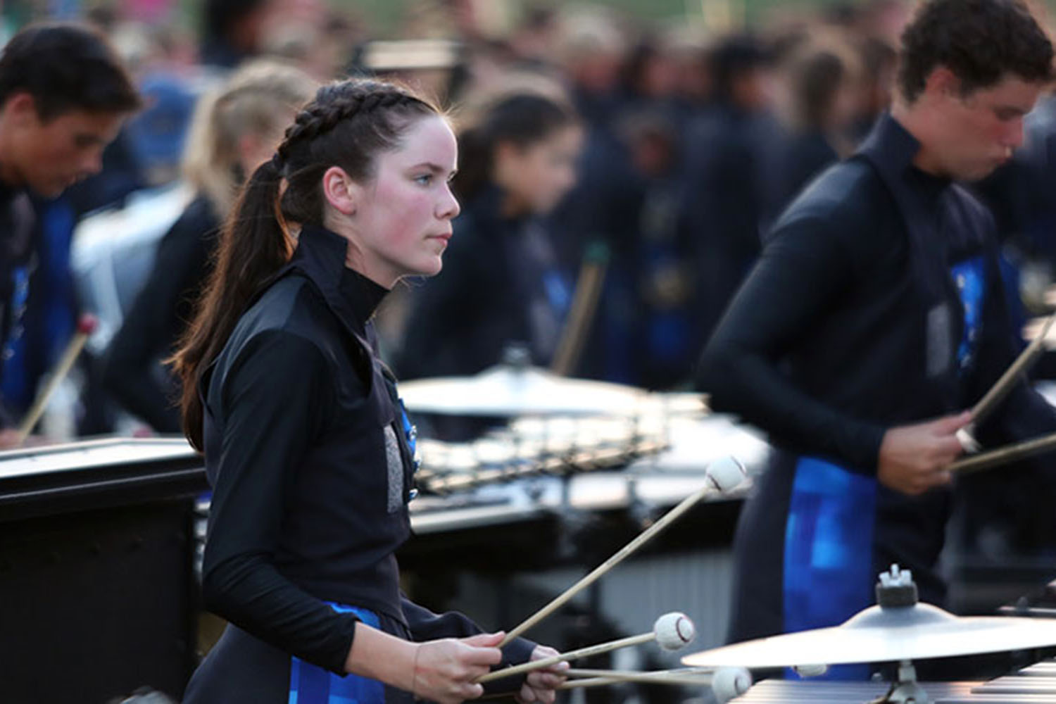 "As the marching band roars behind her, Abby Cascarelli plays the marimba at the Langham Creek football game. ""I love everyone in the front ensemble and performing with them is exhilarating."" The Wildcats won the football game and have only lost one game this year."