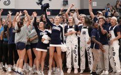 "The Navy Empire cheers for the senior class during the pep rally on Friday, November 15th. ""We loved being loud and obnoxious,"" senior Brooke Forsyth said. The Navy Empire, created to increase school spirit during pep rallies and football games, competed with the other grades to be the loudest and most spirited during the pep rally."