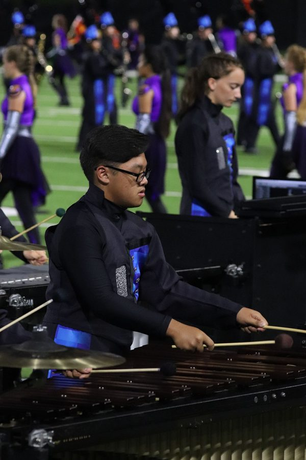 A member of the front ensemble plays during a football game.