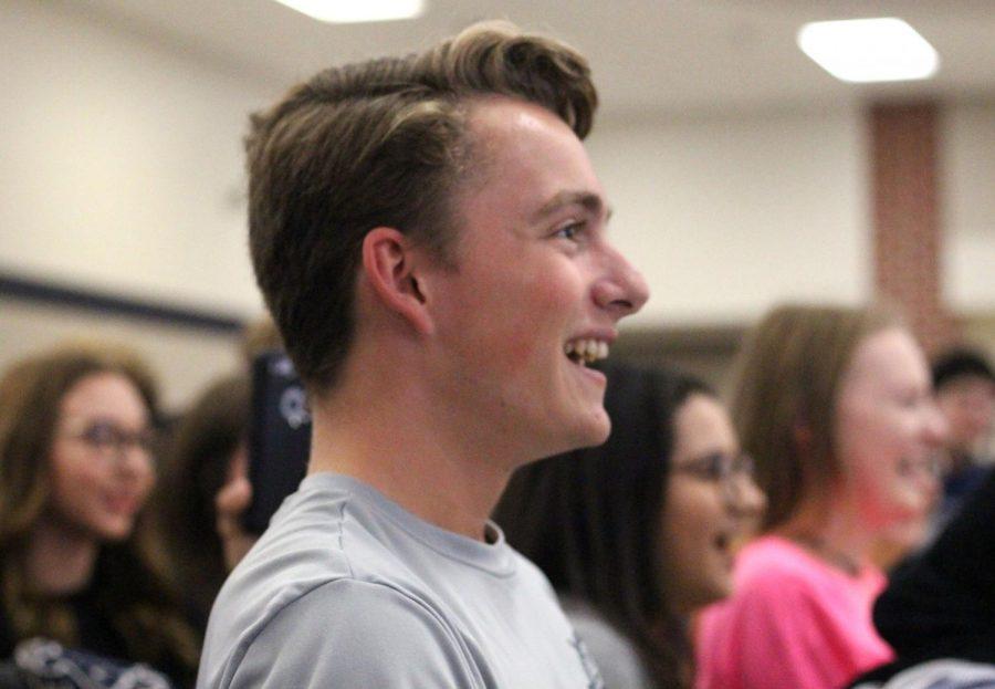 Senior Blaise Alfredson laughs while watching teachers get pied.