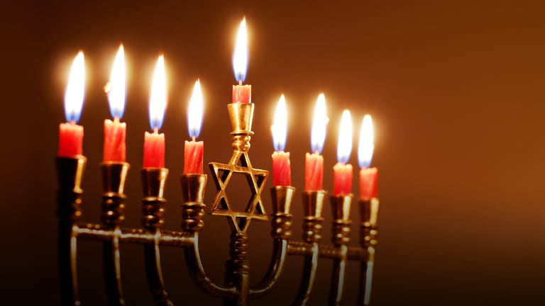 The menorah is used during Hanukkah to symbolize the seven days of creation according to the book of Genesis.