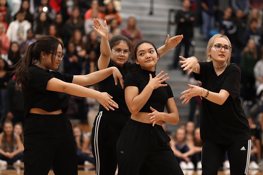 Members of 'Ohana perform at a pep rally.