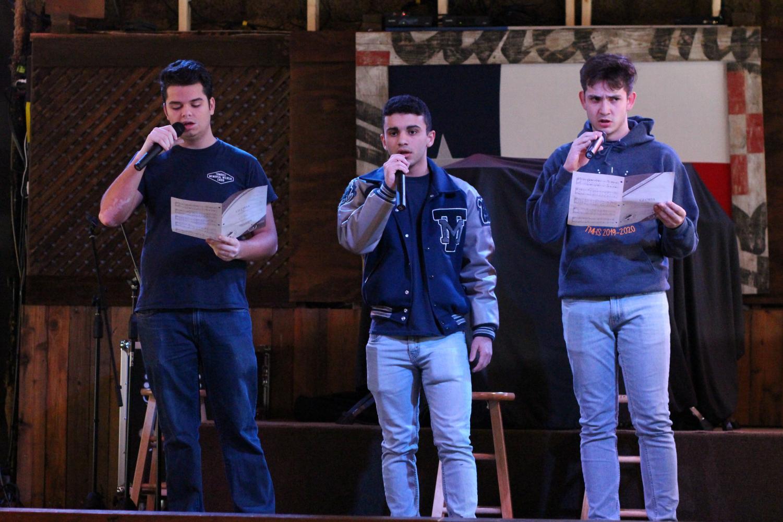 Three students sing at the choir sing-a-thon.