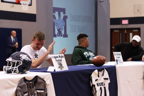 Athletes sit in the gym for signing day.