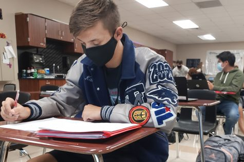 Senior Kaedyn Colton uses Advisory to catch up on his homework. Later, he