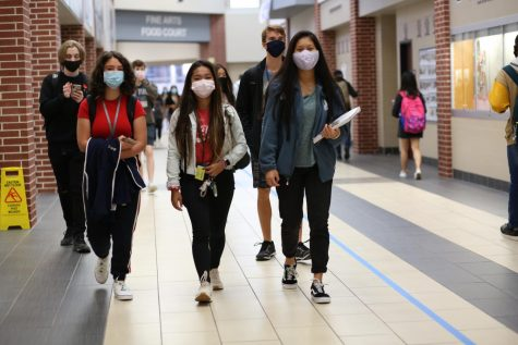 Students wear their mask correctly as they head to their next class for the day.