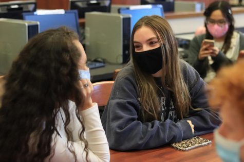 National Honor Society members discuss plans at their first meeting after school in the library. The club