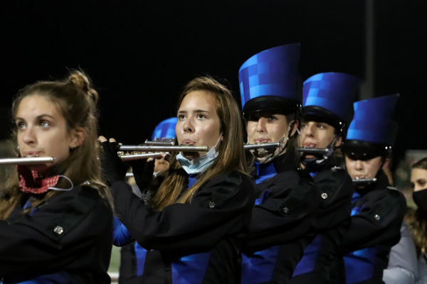 Flute players in band perform during halftime.