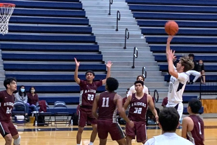 Sophomore Grant Saxon throws up a floater in the Wildcats 66-29 victory over Northbrook. Saxton led the Wildcats in scoring in his third game as a varsity player.