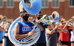 Junior Michael Rodriguez plays the sousaphone at marching band practice after school.