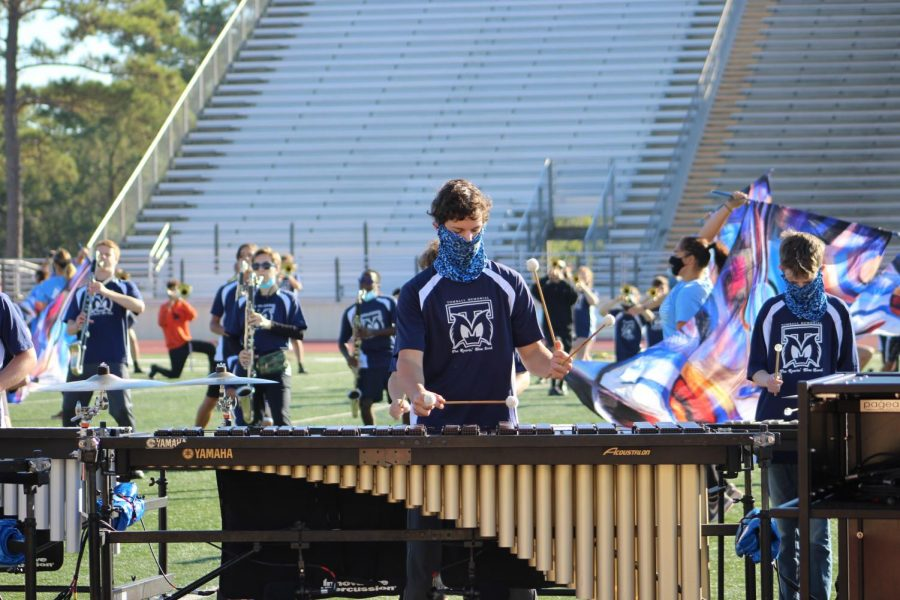 Members of the front ensemble begin warming up. Members arrived by 8:30 a.m. to start practicing.