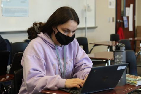 A student works diligently in her fourth period AP Research class. Finals week for all classes is set to begin Monday.
