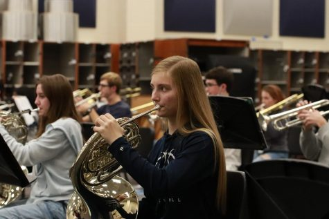 Junior horn player Hannah Jones rehearses in the new band facility.