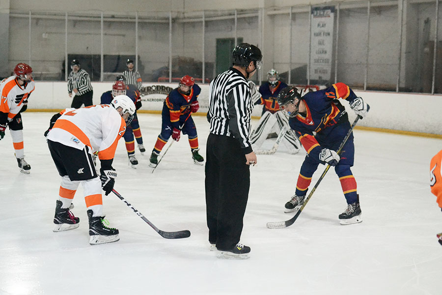 Tristan Hickman skates up for a faceoff in the second period of Tomball Hockey