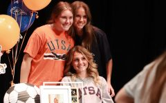 Senior Abigail Wilson poses with family after signing.