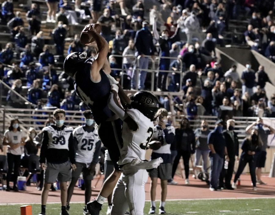 Joseph Manjack leaps for  a receiving touchdown in the second half of a playoff game vs Cypress Park