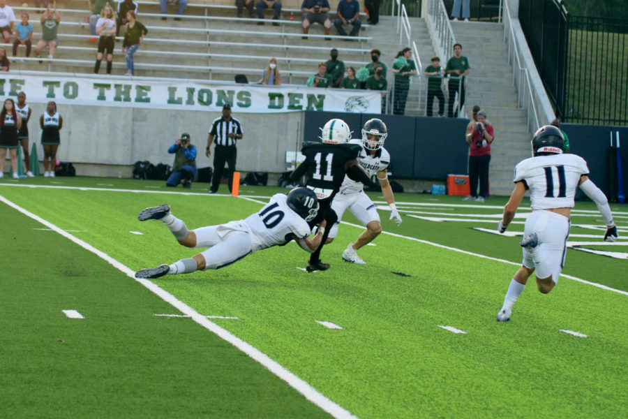 Tyler Torres and Kale Berter attempt to drag down a Spring Wide Receiver before he reaches the end zone