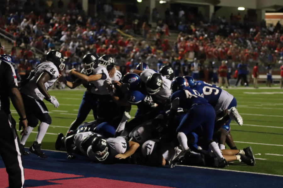 Junior Reed Odell dives over the goal line for a touchdown in the third quarter against West Brook.