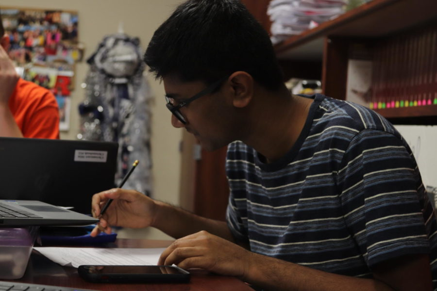 A senior works on an assignment during his AP Government class
